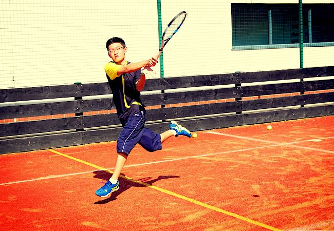 ISSFT student playing tennis